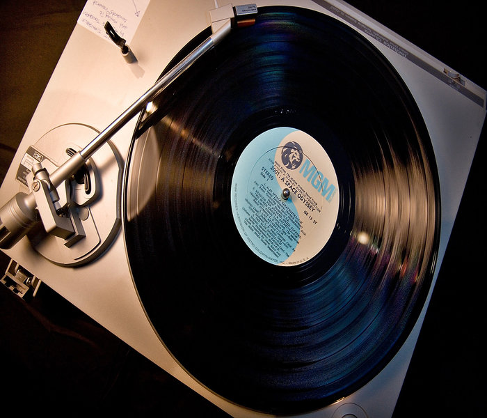 A vinyl record player and a vinyl record being played. Remember that??